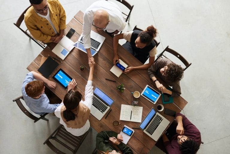 group of people having a meeting at a table